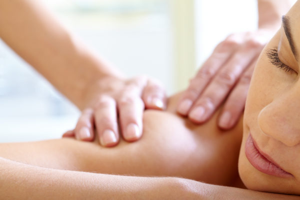 Close-up of calm female enjoying procedure of massage